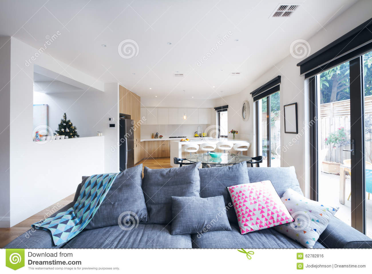 Comfortable grey sofa in open plan living room for Open plan home