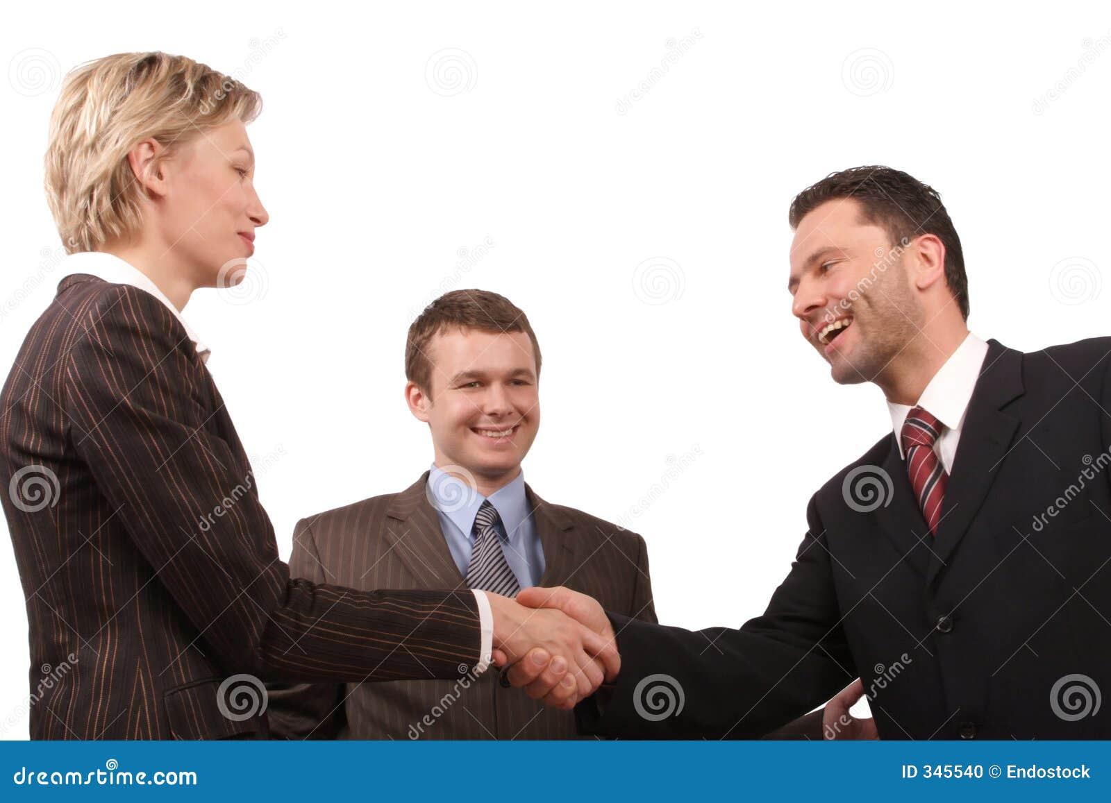 Commerciële vergadering - man en vrouwenhanddruk