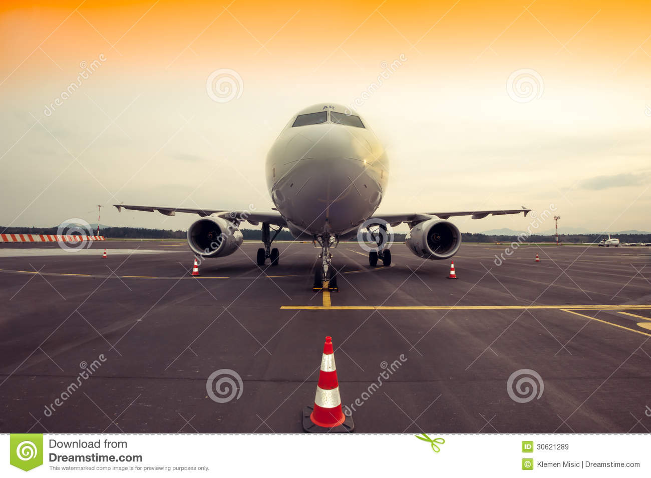 Commercial Airplane Parking At The Airport With Traffic