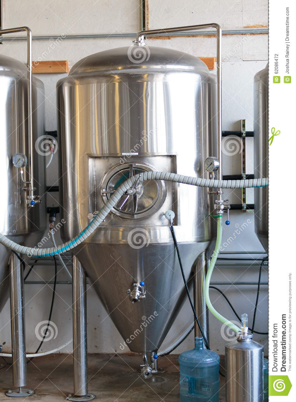 Commercial craft beer making at brewery editorial for Craft a brew fermenter