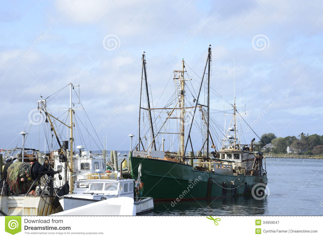 Commercial fishing boats in a harbor royalty free stock for Large fishing boats