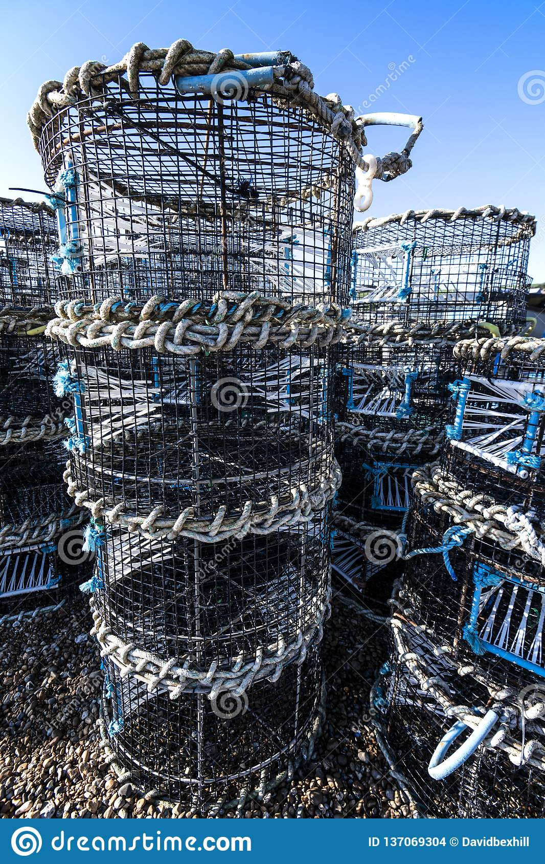Lobster pots on Hastings fishing quarter stade at Rockanore in East Sussex, England