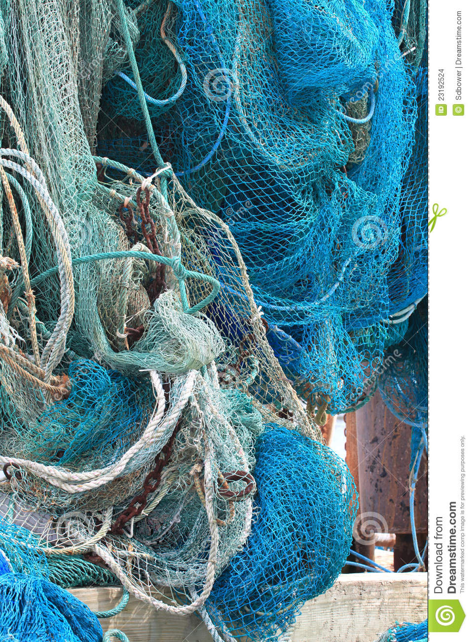 Commercial fishing net hanging out to dry stock images for Florida commercial fishing license