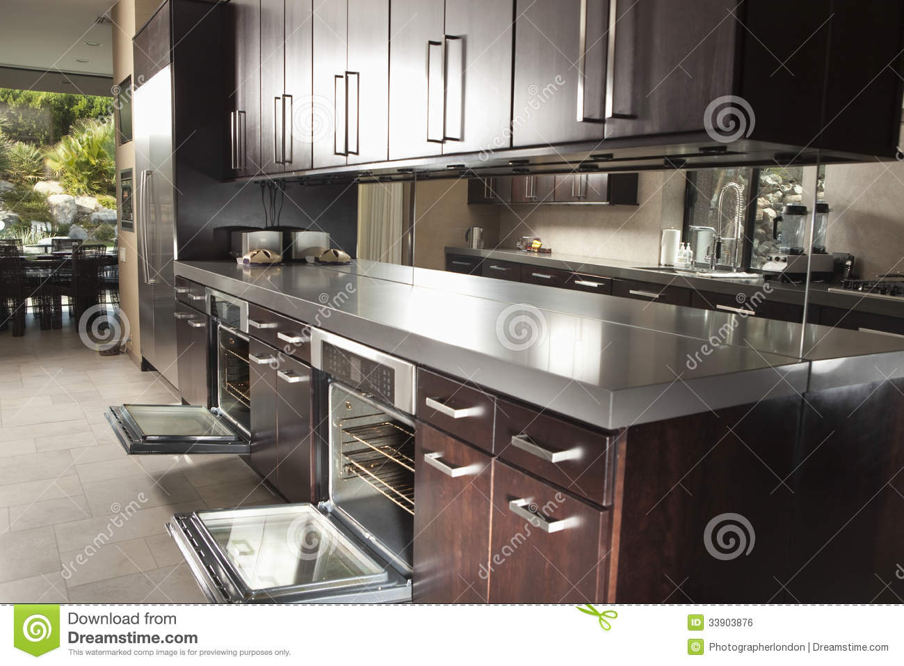 commercial kitchen with open oven and cabinets royalty free stock