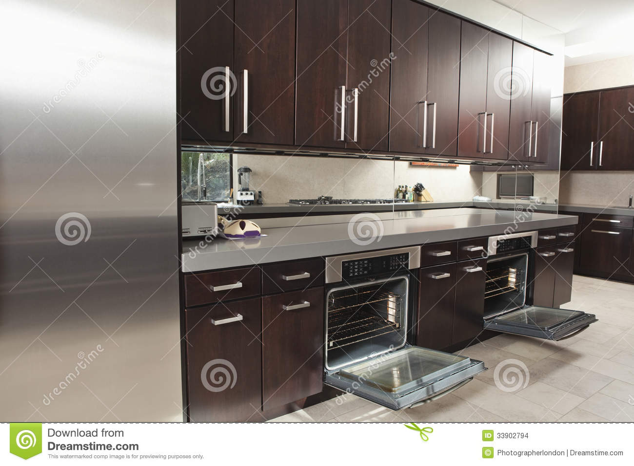 commercial kitchen with open oven and cabinets stock images