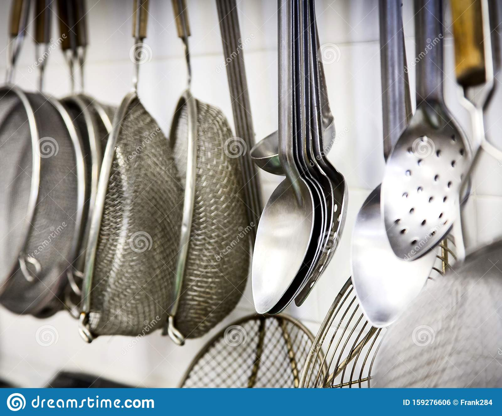 Commercial Kitchen Utensils Hanging On A White Wall Stock Photo Image Of Wall Hanging 159276606