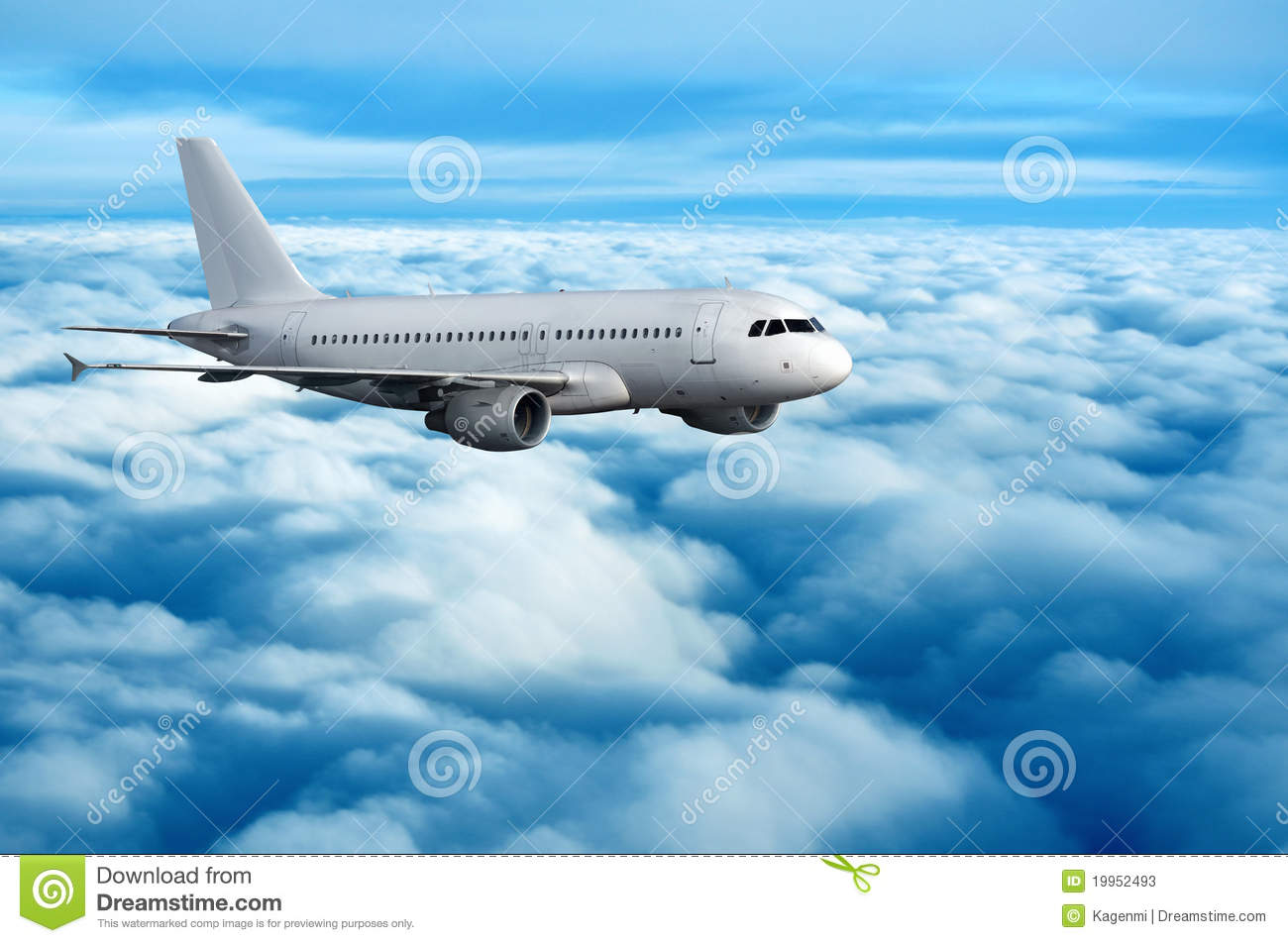 Commercial passenger airplane flying over clouds stock photos image