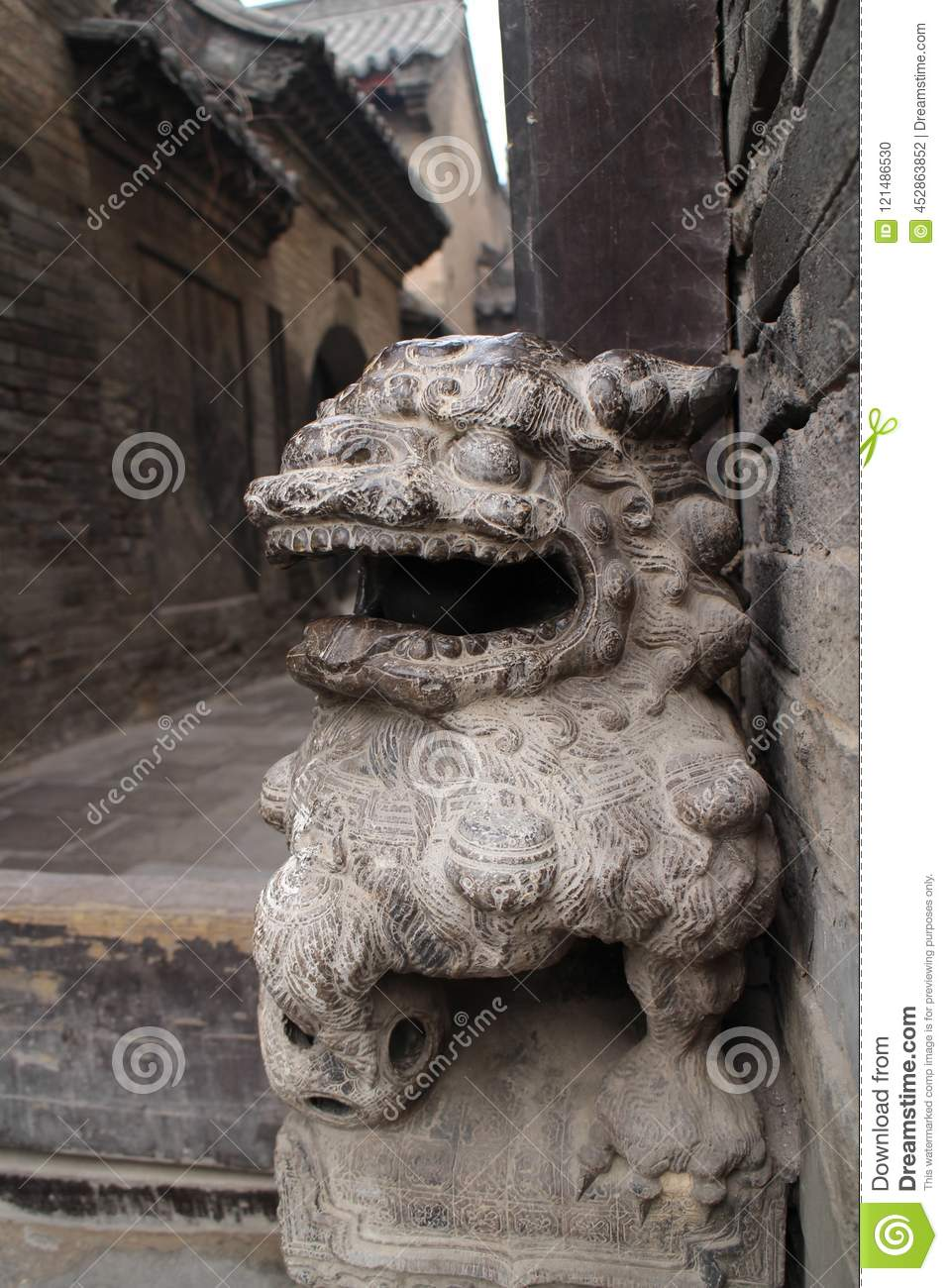 Stone carving lion in a ancient architecture,shanxi,china