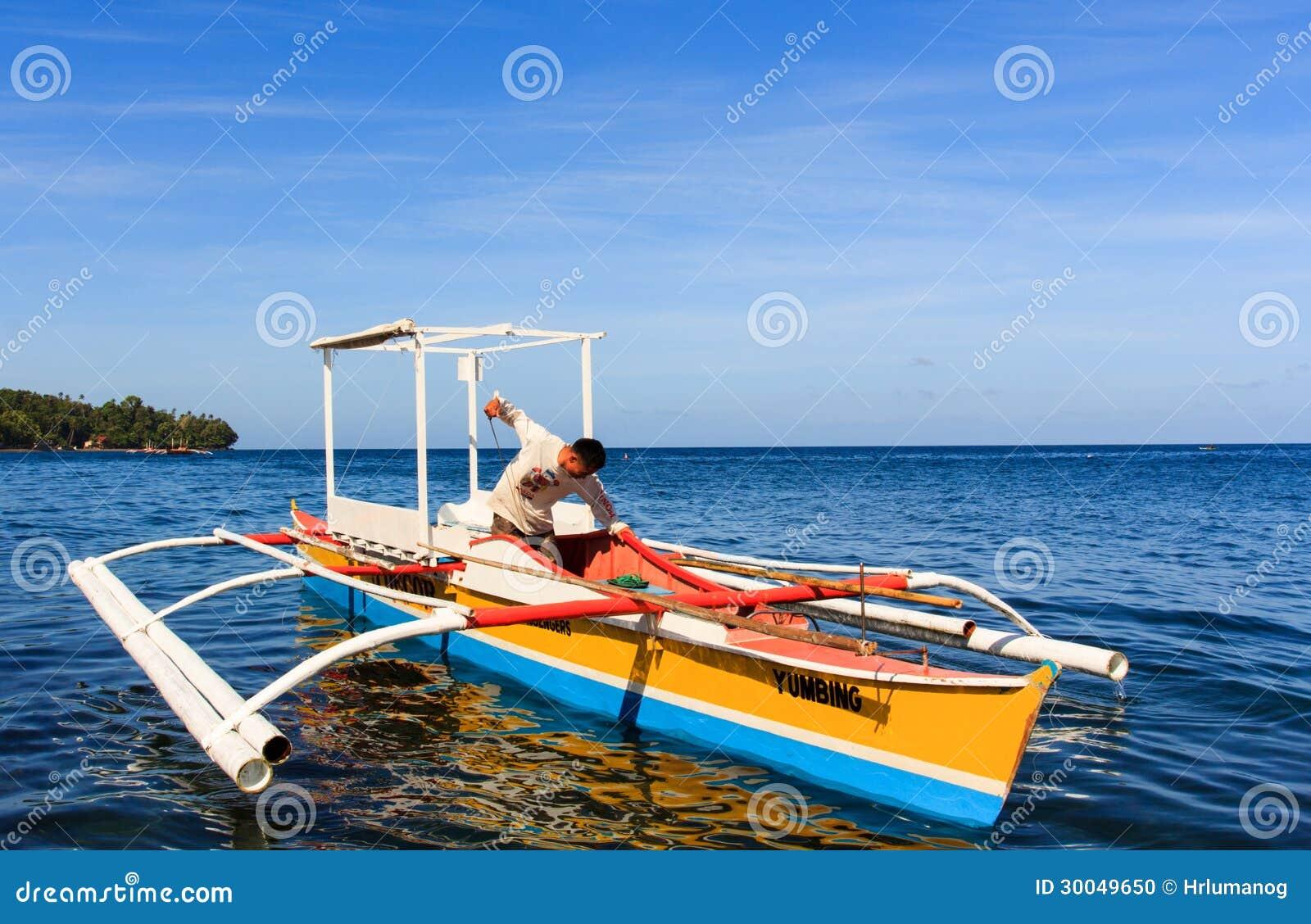 outrigger canoe called bangka in camiguin island editorial image