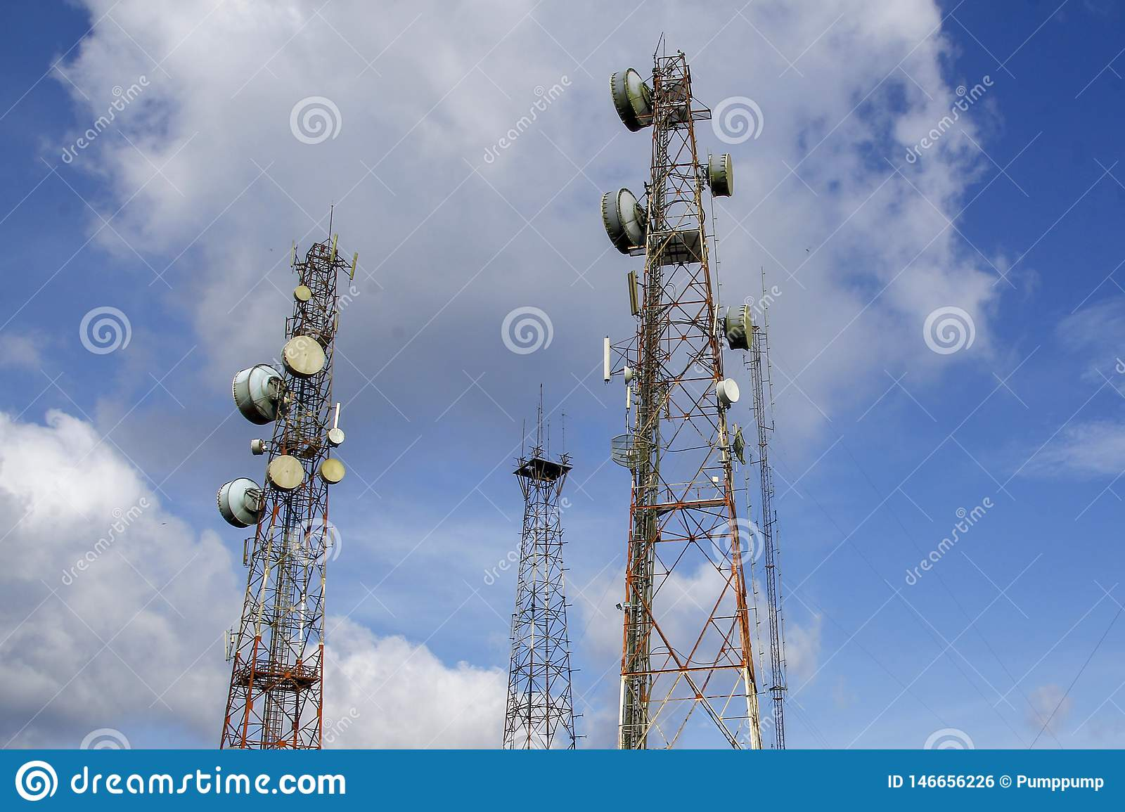 communication and telecommunication pole in nature on blue sky at asia