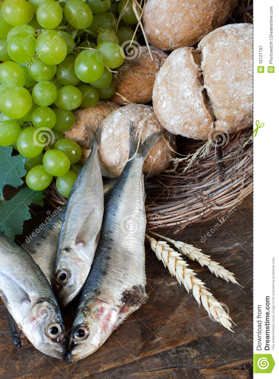 Communion bread with fish and grapes royalty free stock for Fishing with bread