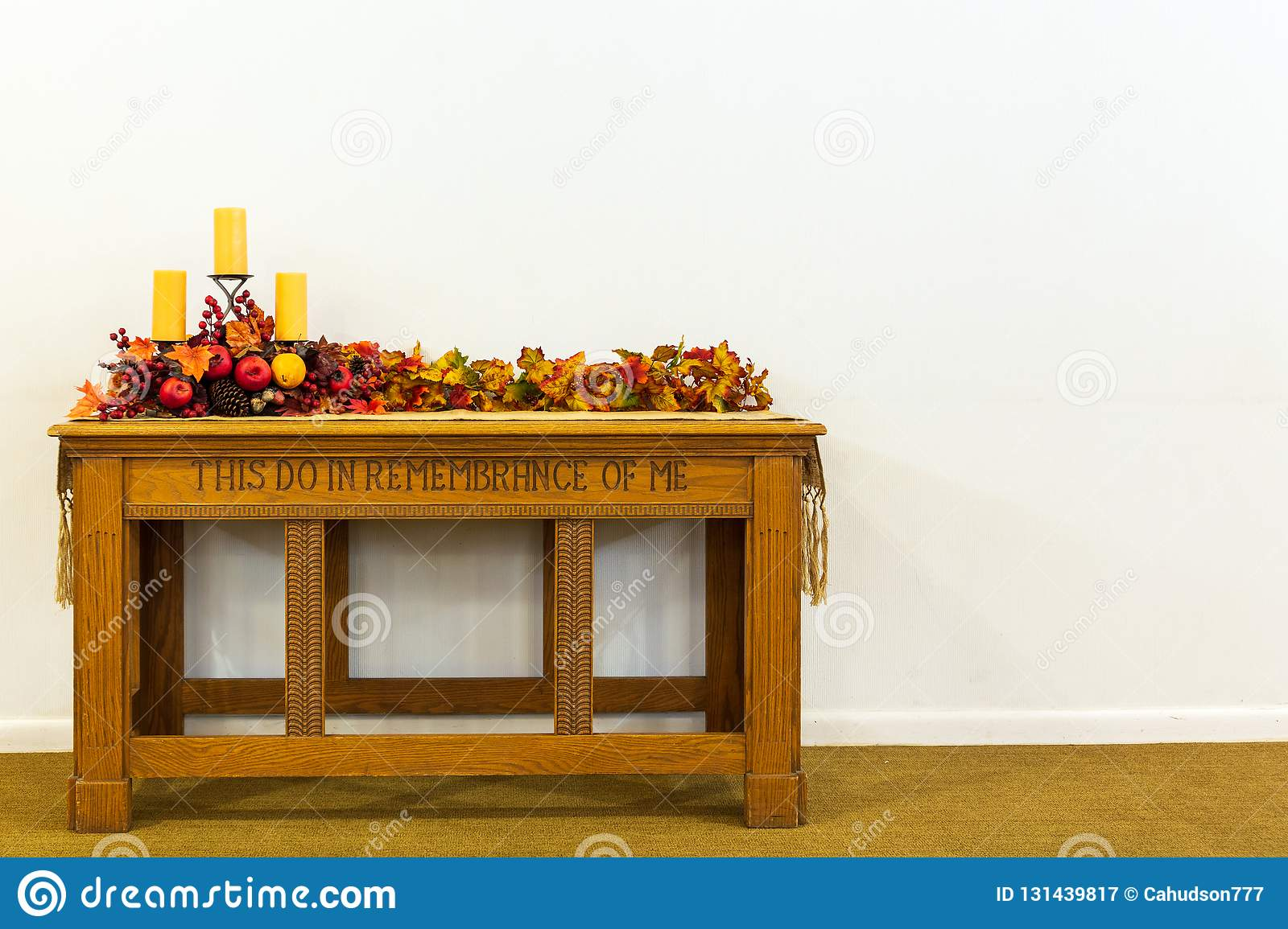 Communion table decorated with candles and colored leaves on a isolated background