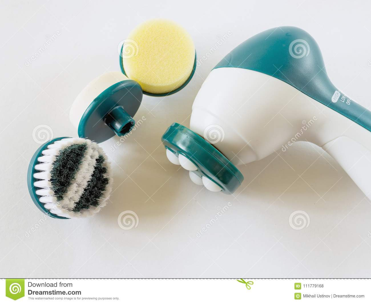 Compact massager with replaceable nozzles