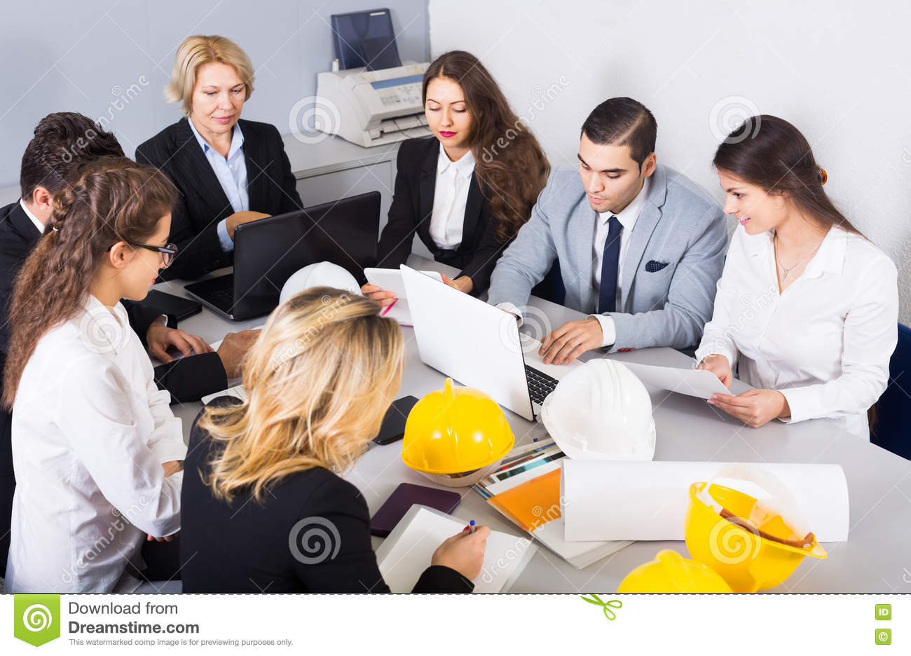 Company Of Architects Brainstorming In Office Stock Image