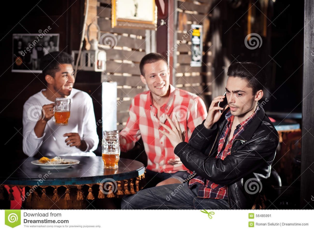 company at the bar talking on phone stock photo image