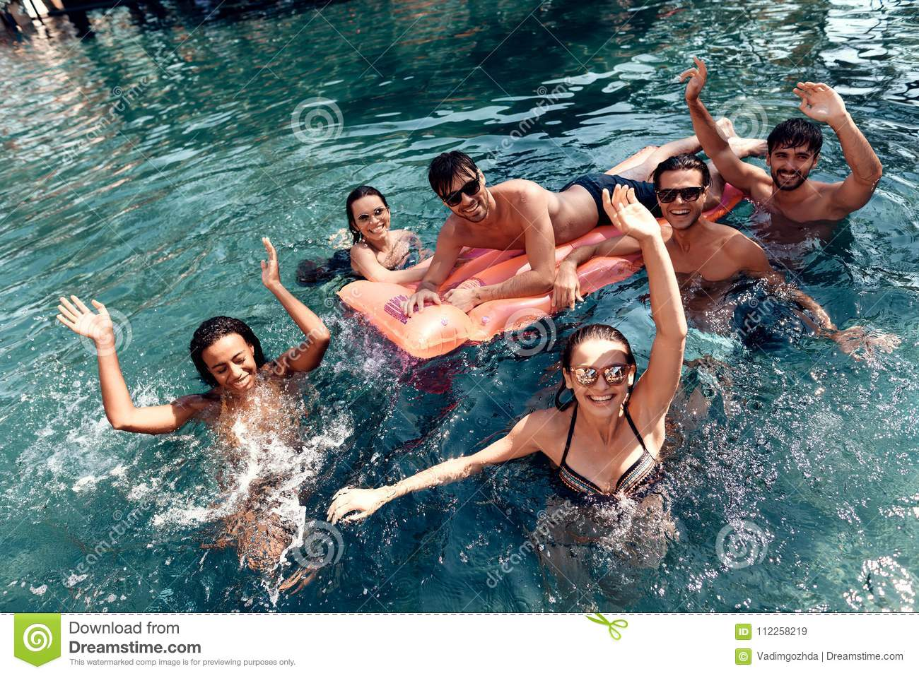 Company of happy friends carefree spend time swimming in pool swimming pool party concept for Wetherby swimming pool swim times