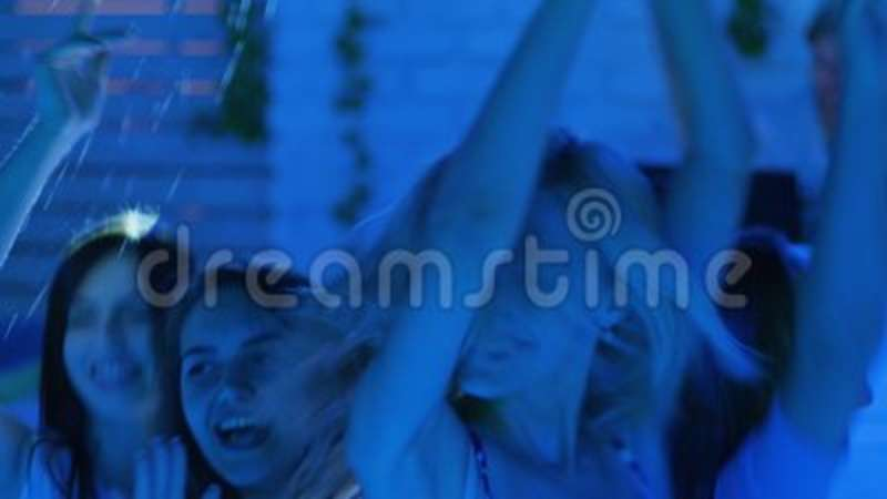 Company Of Modern Youth Dancing And Jump To Disco Party In Night