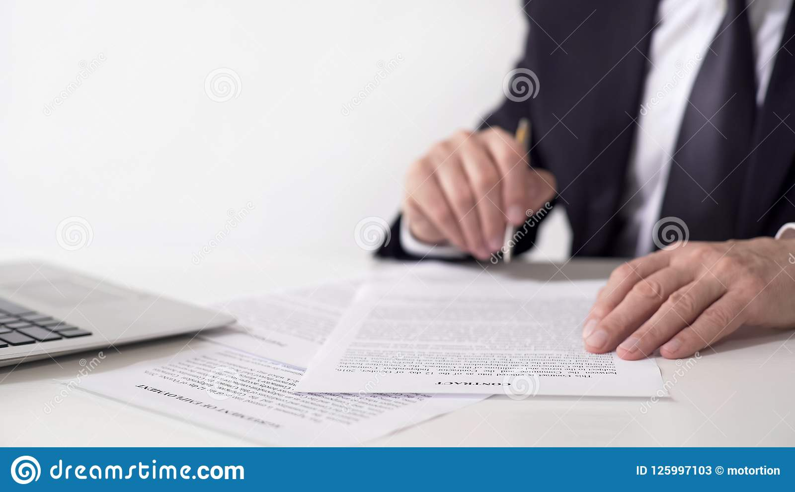 Company president reading contract, signing important cooperation agreement
