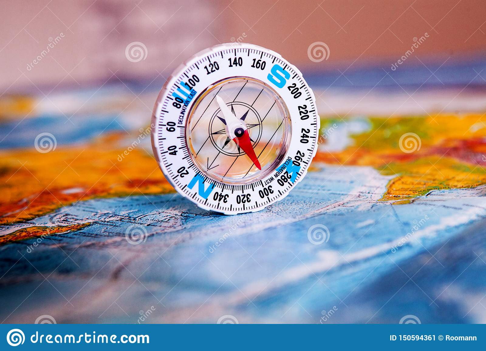 Compass on map. The magnetic compass is located on a geographic map. Satellites adventure. Travel concept.