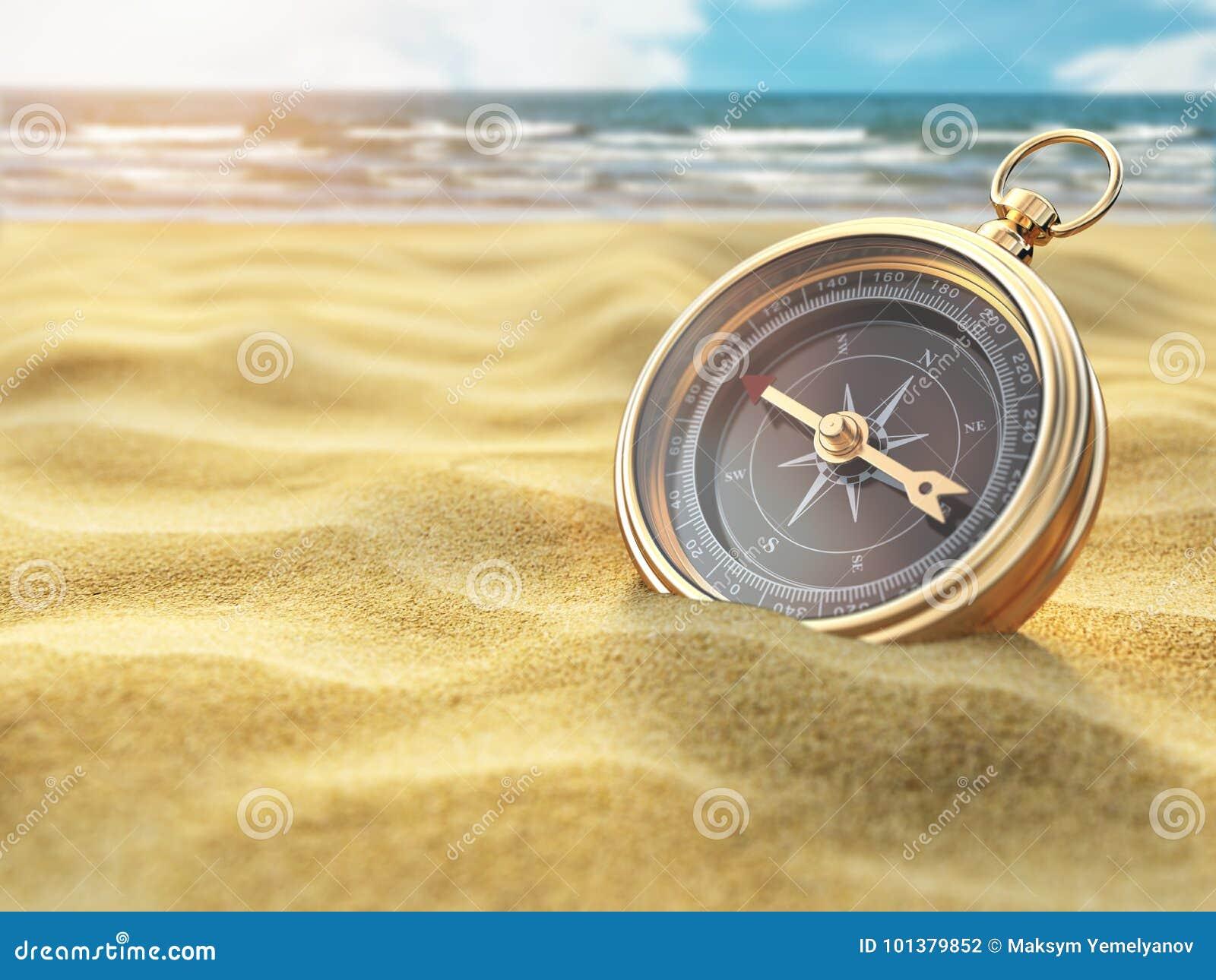 Compasso na areia do mar Destino do curso e conceito da navegação