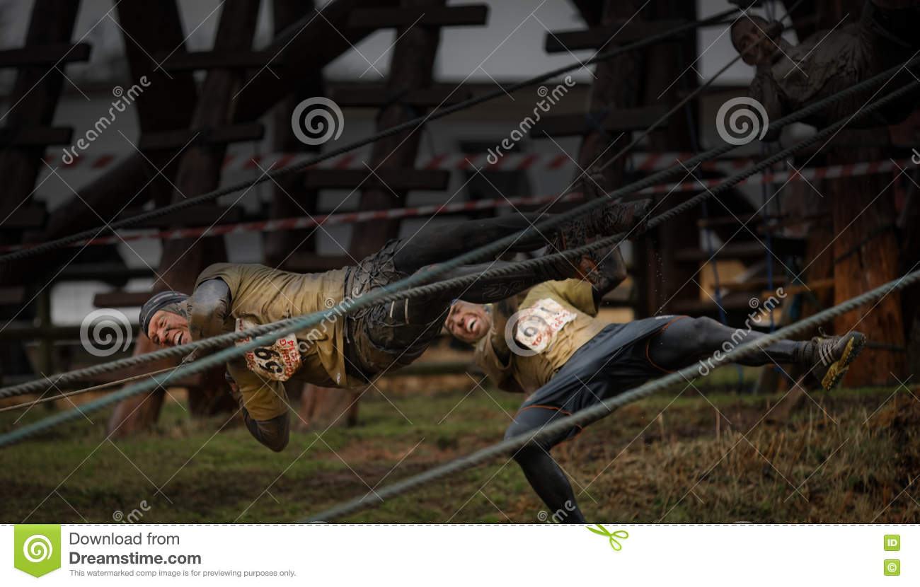 Competitors falling from ropes at 2014 Tough guy obstacle race