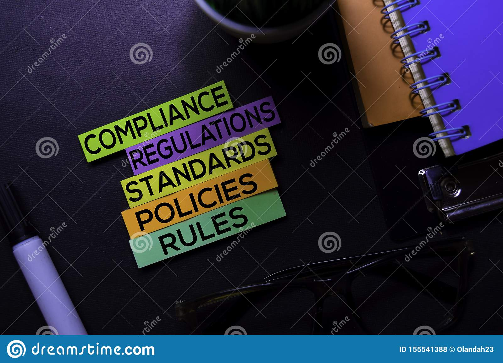 Compliance, Regulations, Strandards, Policies, Rules text on sticky notes isolated on Black desk. Mechanism Strategy Concept