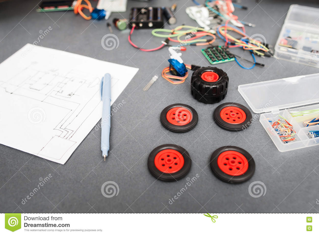 components and scheme of constructing car at home  engineer workplace with wiring  diagram and wheels for toy truck, diy modeling, modern technologies, hobby