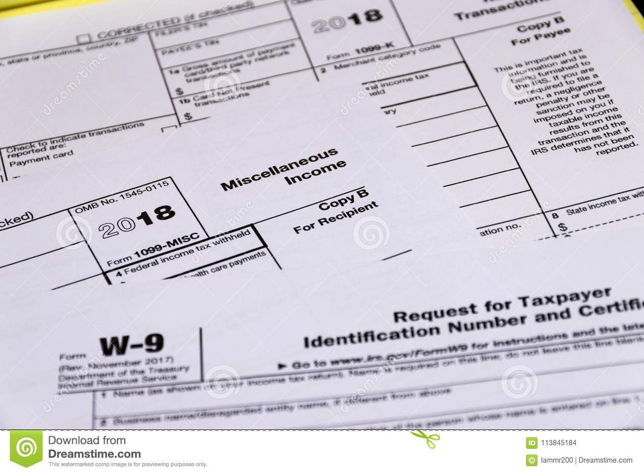 Shot Of IRS Tax Forms 1099-M, 1099-K And W-9 Editorial Stock