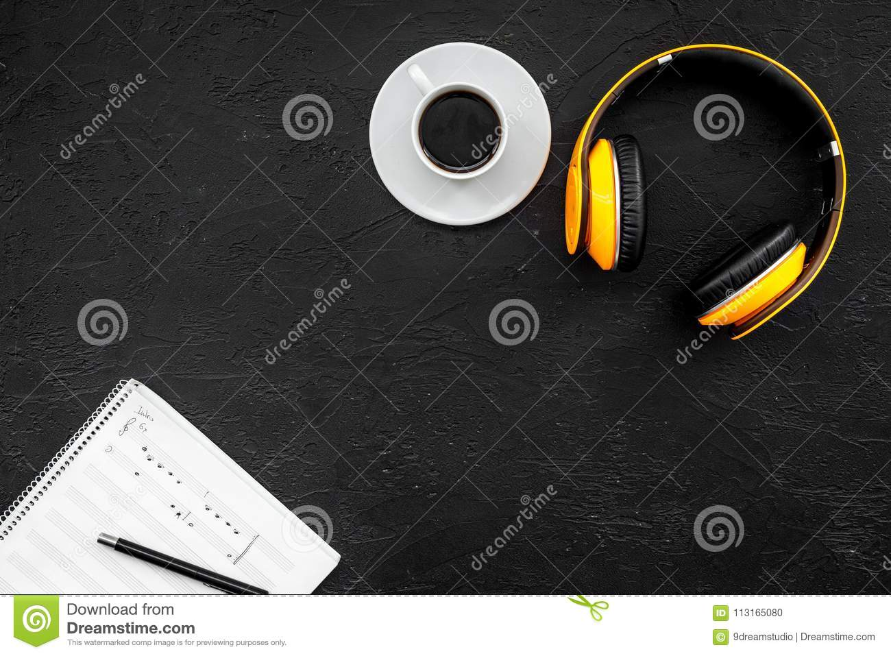 Composer And Song Writer Desktop With Headphones And Notes On Black