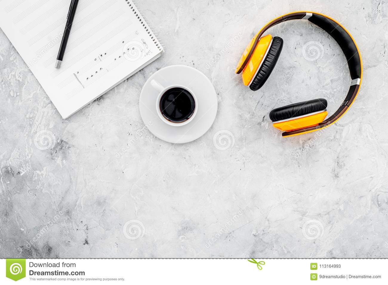 Composer And Song Writer Desktop With Headphones And Notes On Stone