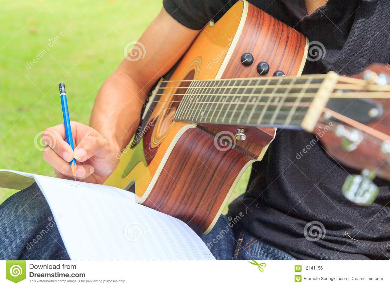 composer write note of song and use acoustic guitar stock