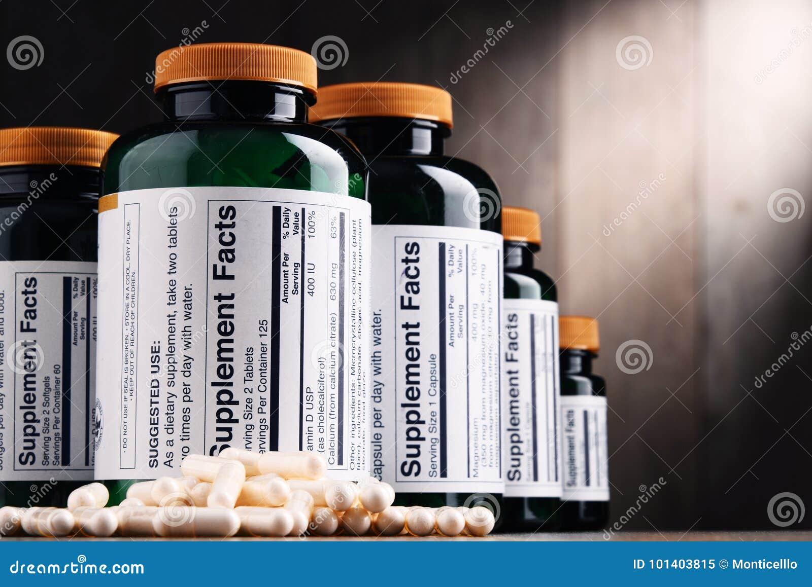 Composição com os recipientes do suplemento dietético Comprimidos da droga