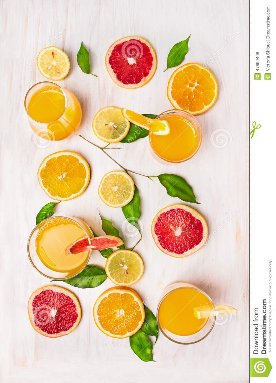 Composing of Citrus juices and a slice of orange,grapefruit and lemon with green leaves
