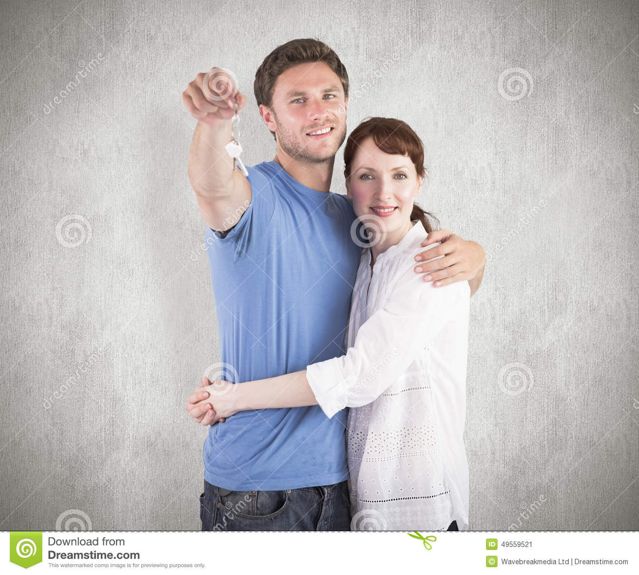 Composite image of couple holding keys to home