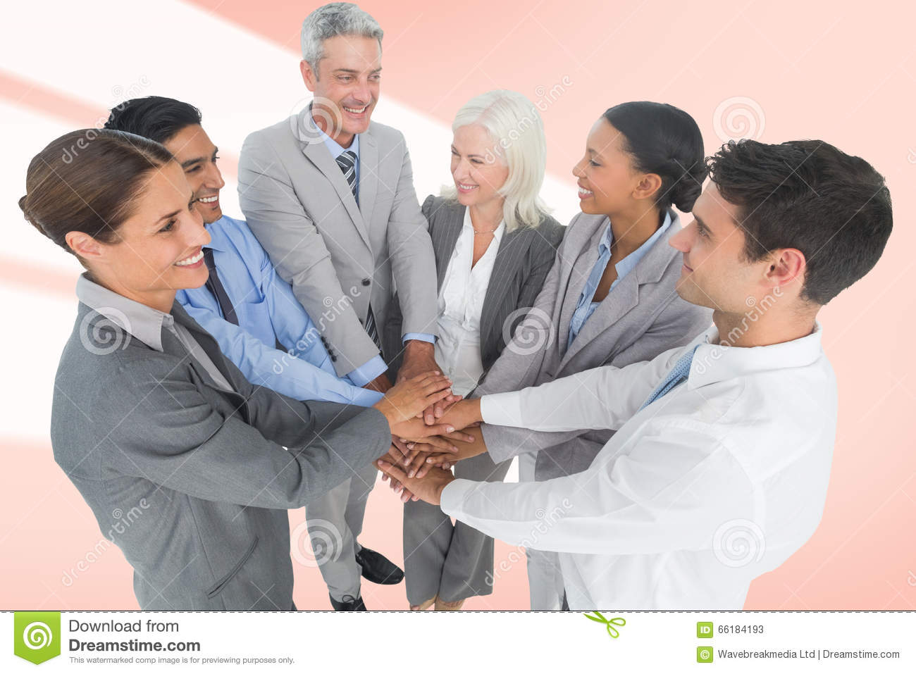 Composite image of executives holding hands together in office