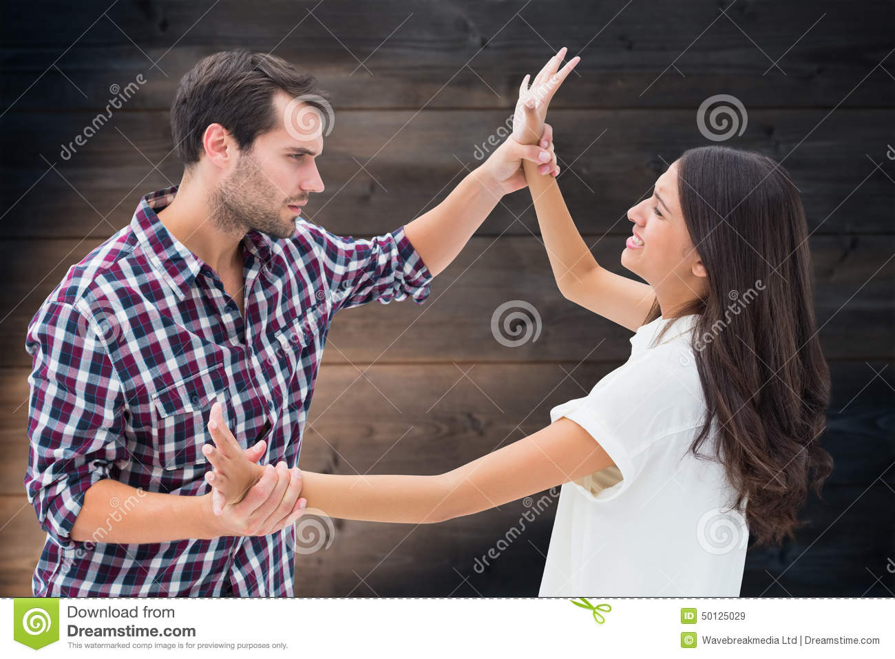 Composite image of fearful brunette being overpowered by boyfriend