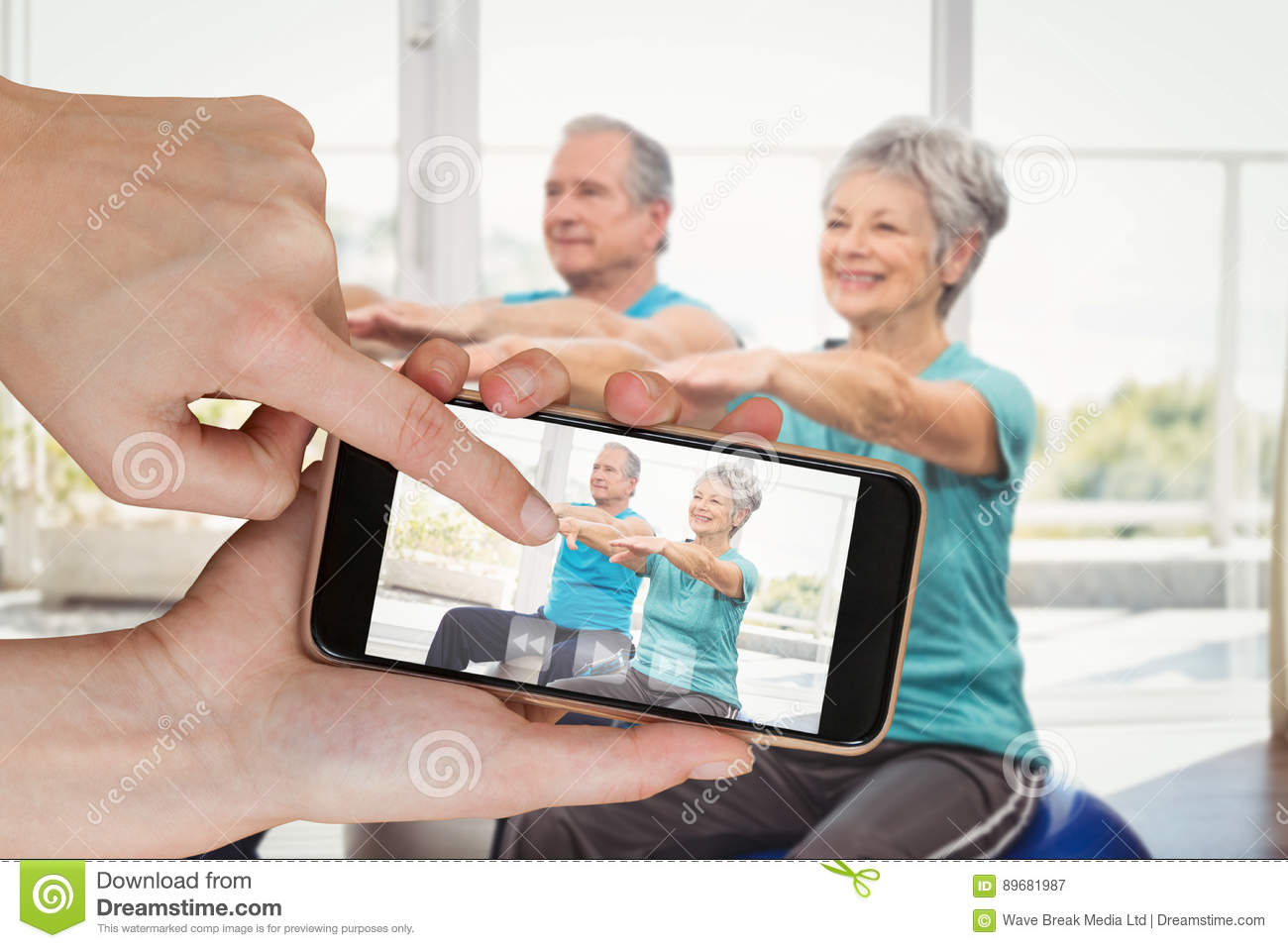 Composite image of hands touching smart phone