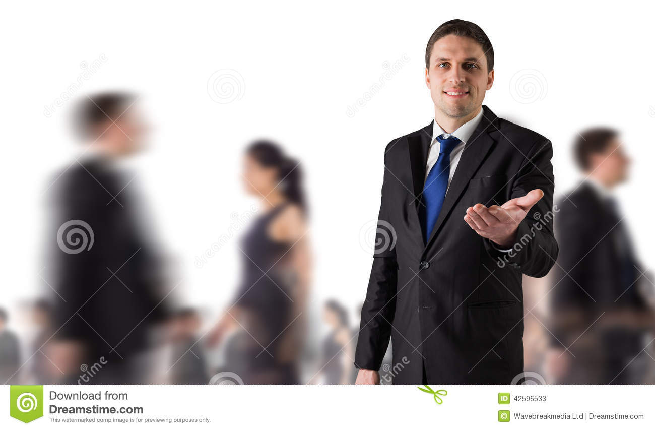 Technology Management Image: Composite Image Of Handsome Businessman Holding Hand Out