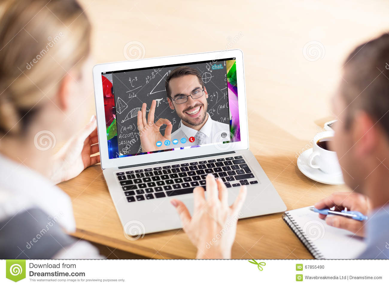 Composite image of happy businessman making okay gesture