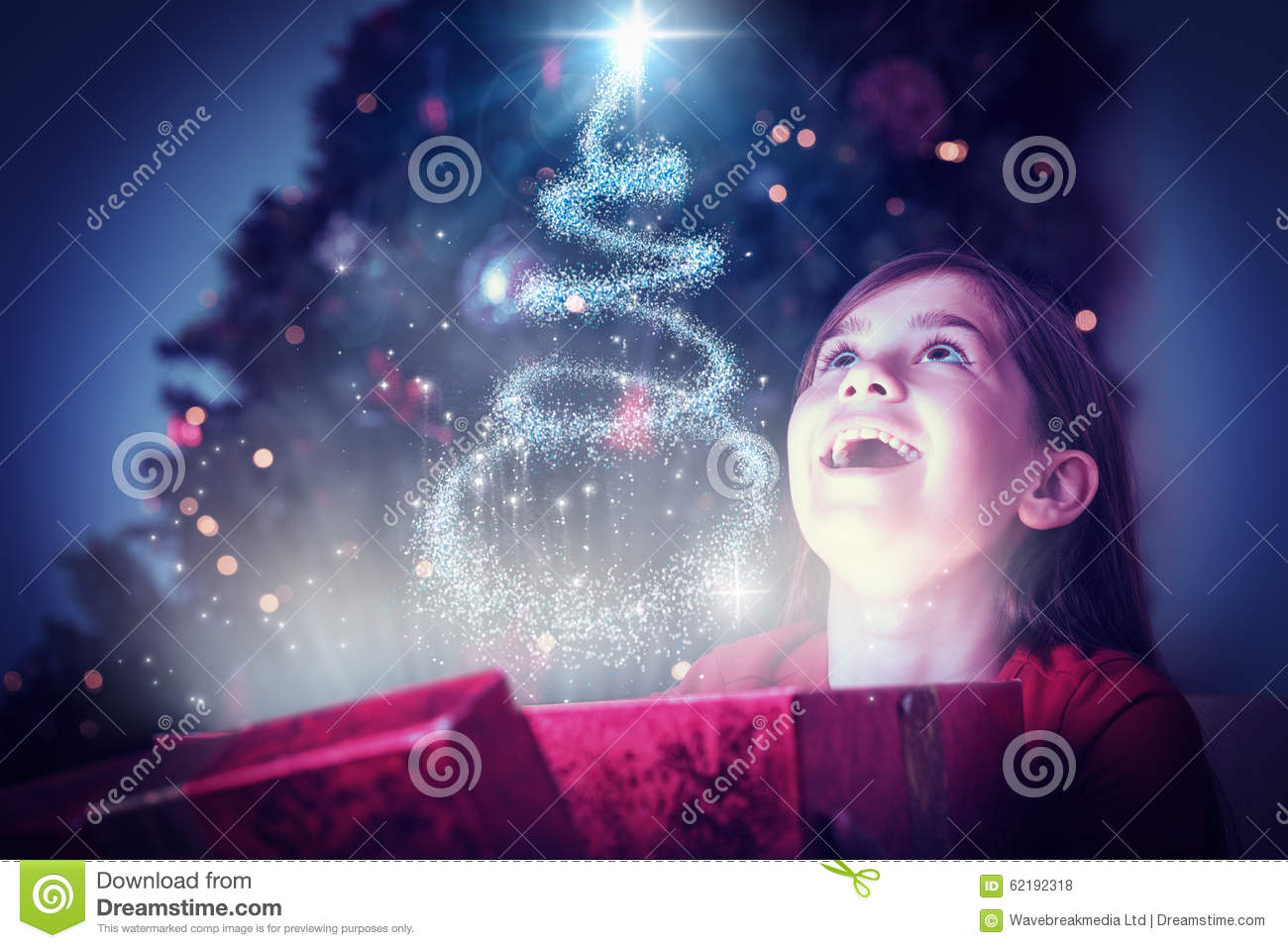 Composite Image Of Little Girl Opening A Magical Christmas Gift ...