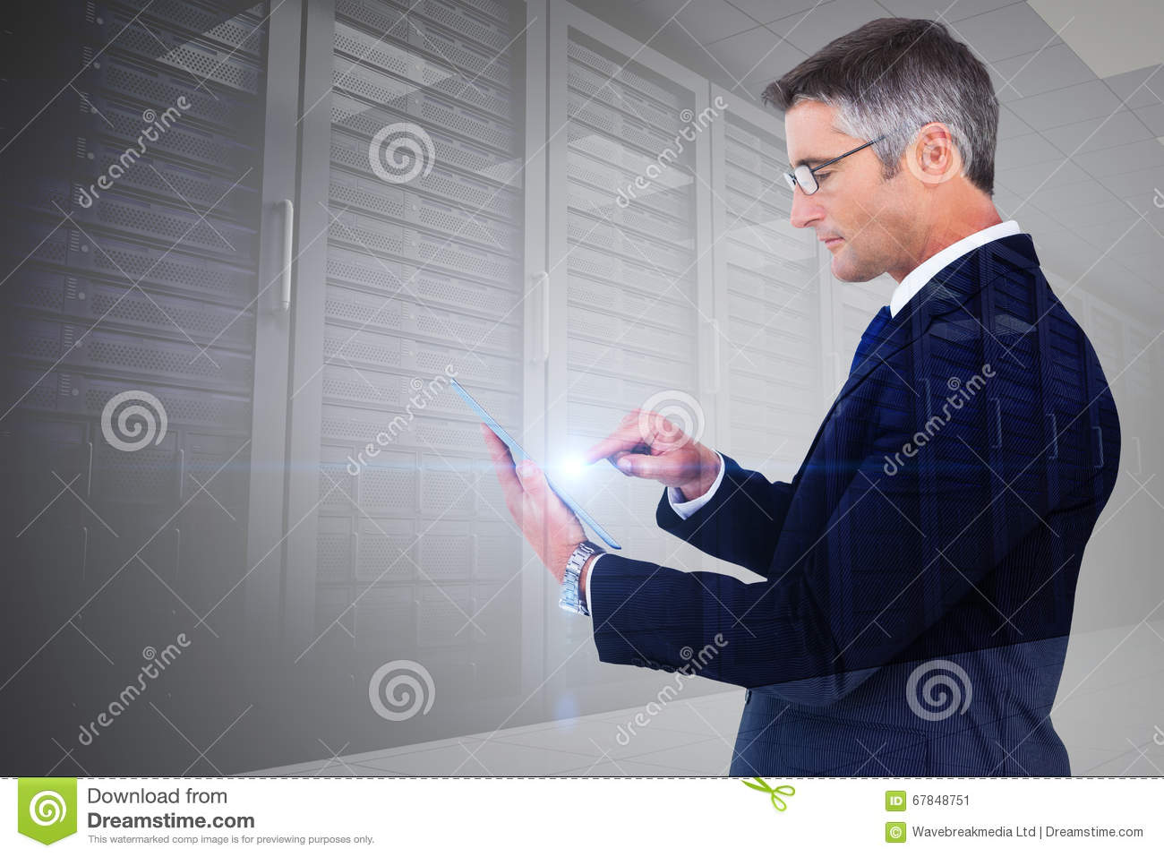 Composite image of mid section of a businessman touching tablet