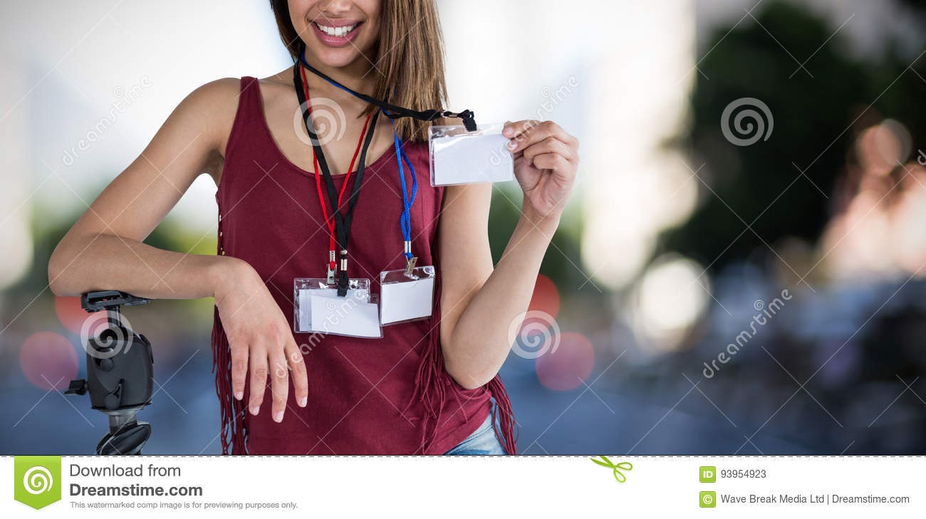 Composite image of portrait of happy woman holding identity card