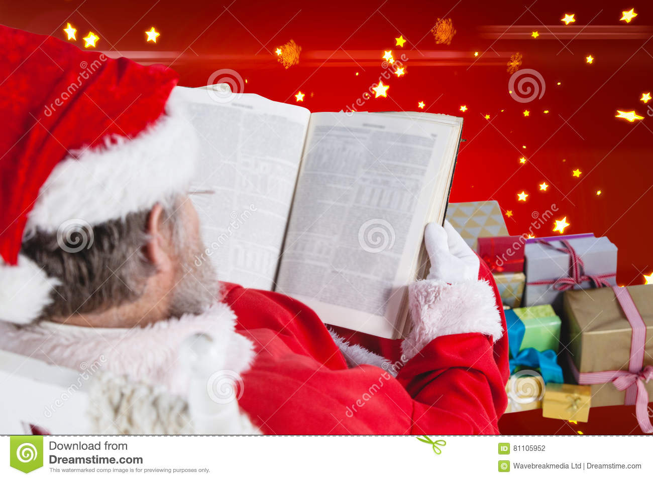Composite Image Of Santa Claus Reading Bible With Christmas Present ...