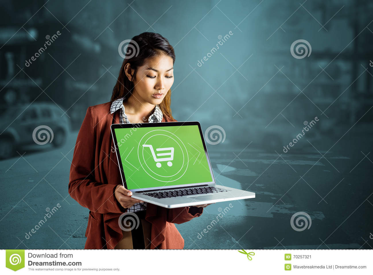 Composite image of smiling businesswoman showing a laptop