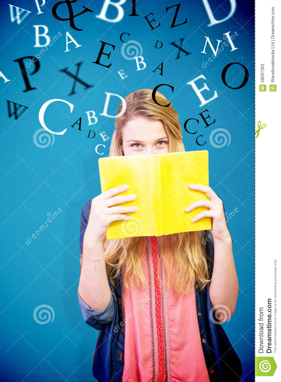 Book Covering Face : Composite image of student covering face with book in