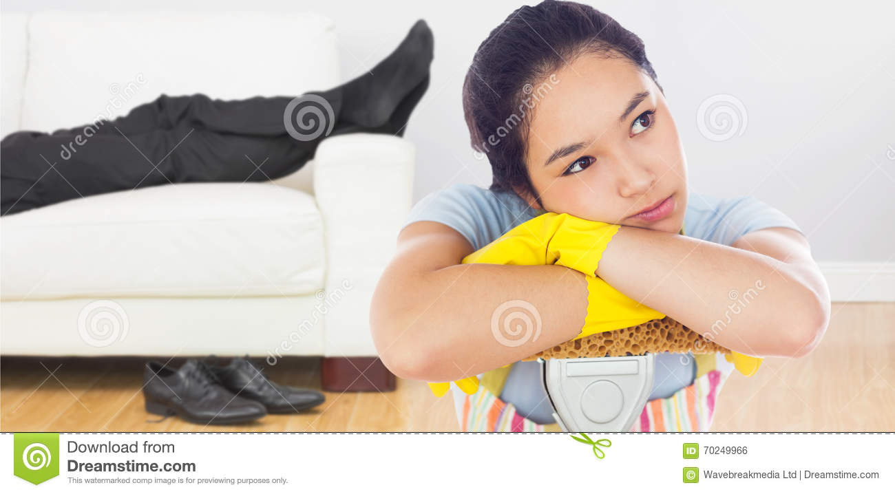 Composite image of troubled woman leaning on a mop
