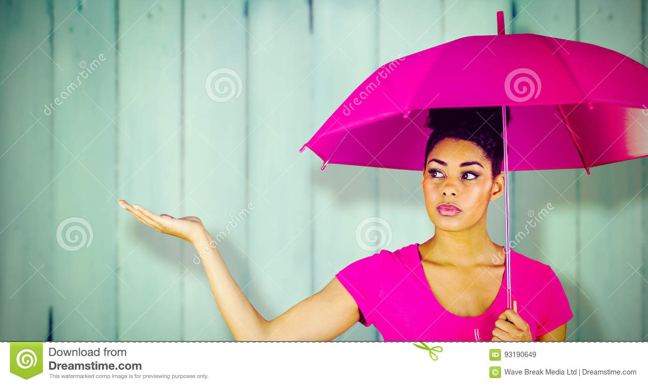 Composite image of young woman carrying pink umbrella