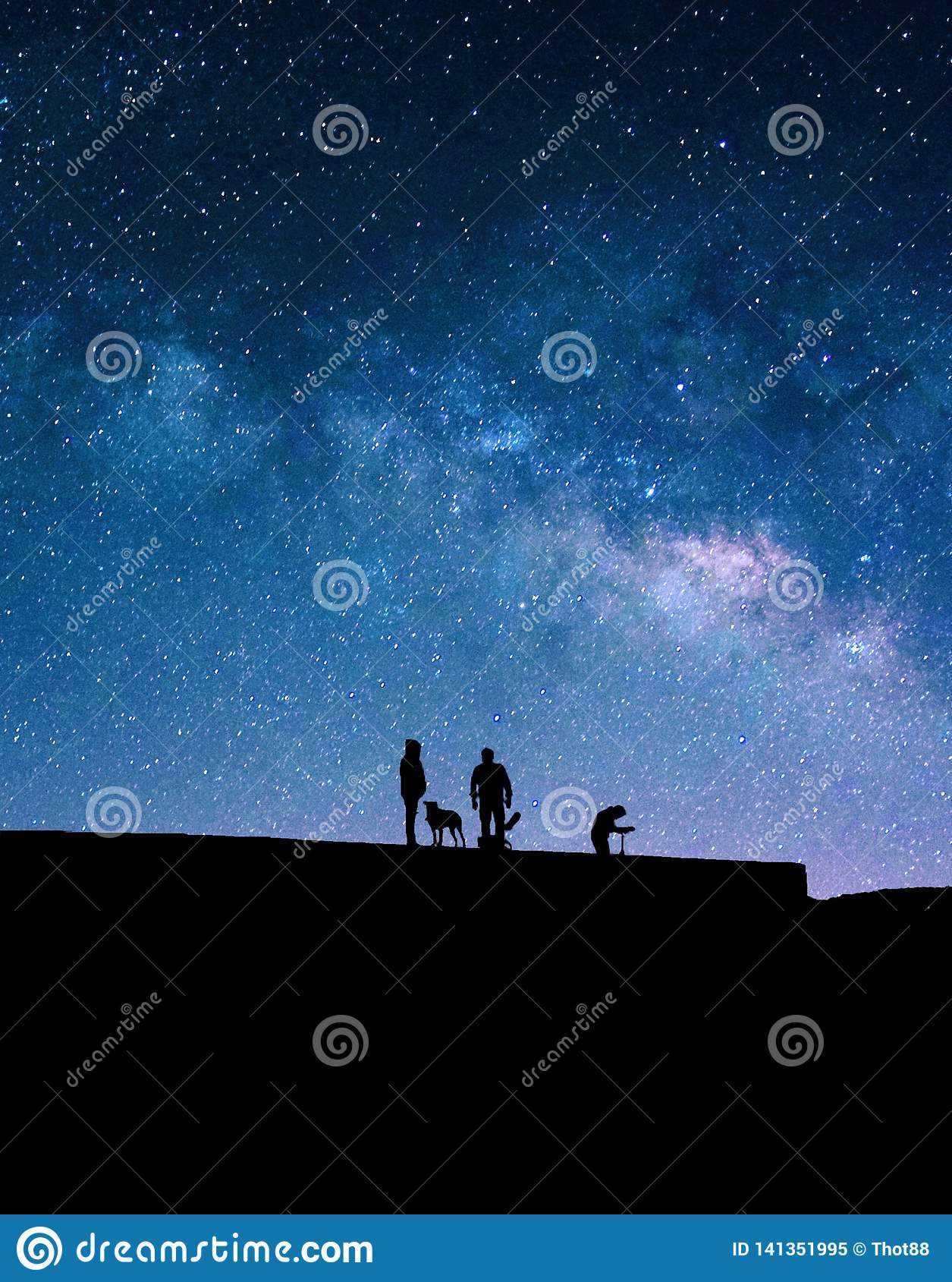 Milky Way and silhouettes of people.