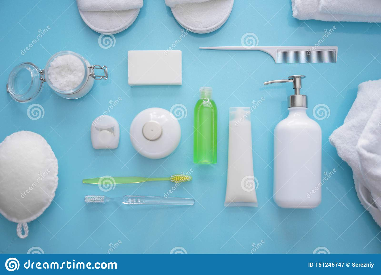 Composition with bathroom amenities on color background