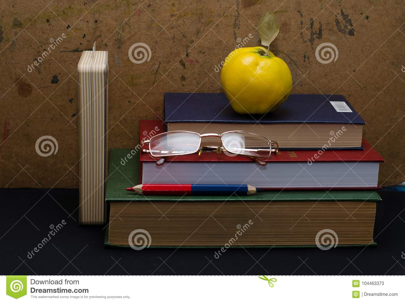 Office work space on grey desk with green apple stock photo.